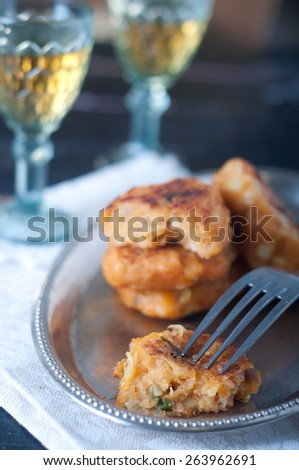 Fish fingers and fishcake burgers on a plate - stock photo