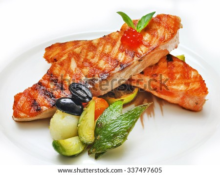 fish, fish dish, orange on the plate on a white background
