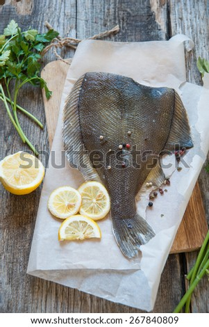 Fish flounder with spices - stock photo
