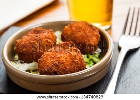 Fish fritters wit beer glass. - stock photo