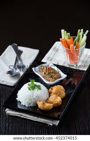 fish fritters with rice and sauce spicy /styling - stock photo