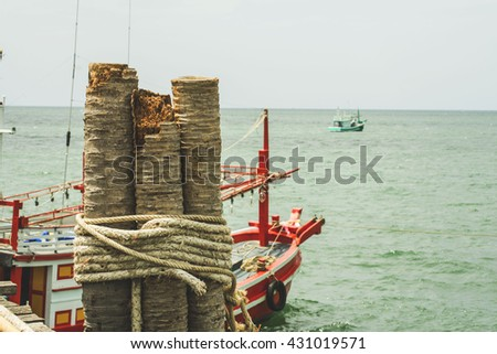 Fish is a meeting of fishermen returning from fishing . All boats must be caught fish coming up at the fishing pier . - stock photo