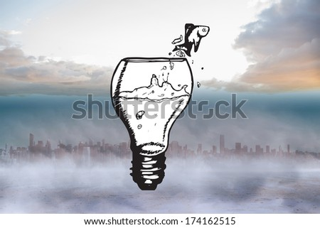 Fish jumping out of light bulb bowl against cityscape on the horizon