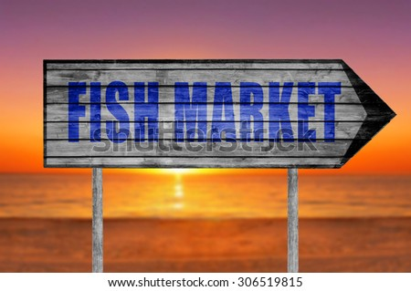 Fish Market wooden sign with on a beach background - stock photo