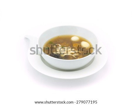 Fish maw soup in white bowl on white background ( Thai food style)