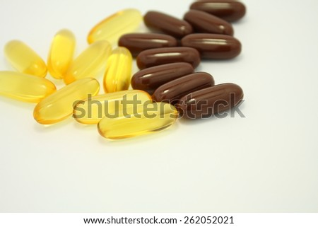 fish oil and ginseng soft gel capsules supplement medicine isolated on white background - stock photo