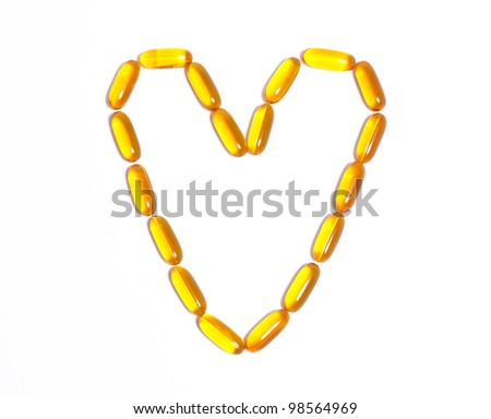 Fish oil capsule in the shape of a heart - stock photo
