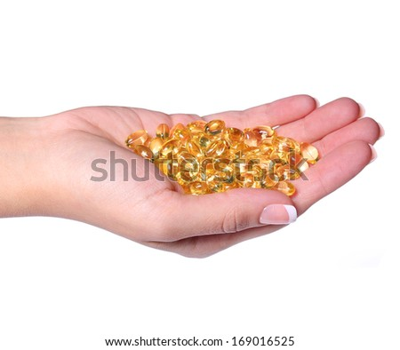 Fish Oil Capsules in Female Hand isolated on white. Omega-3 Pills. Vitamin  - stock photo
