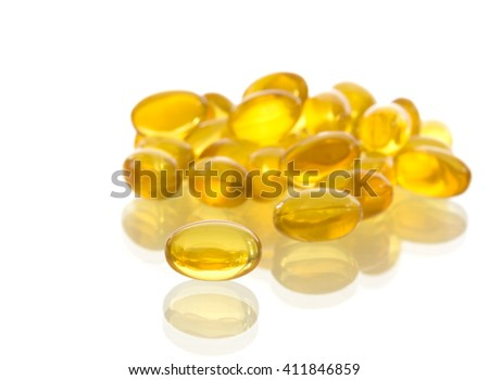 Fish oil capsules on white background. Health care concept.