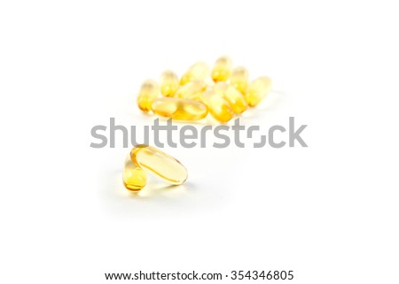Fish oil capsules on white background, stock photo - stock photo