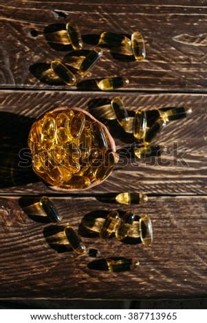 Fish oil capsules,  vitamins omega, vitamin E. - stock photo