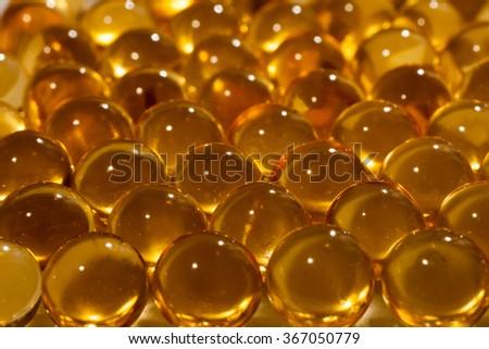 fish oil in the capsules - stock photo