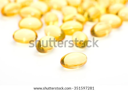 Fish oil omega 3 gel capsules isolated on white background - stock photo