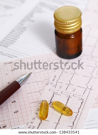 Fish oil pills for heart health - stock photo