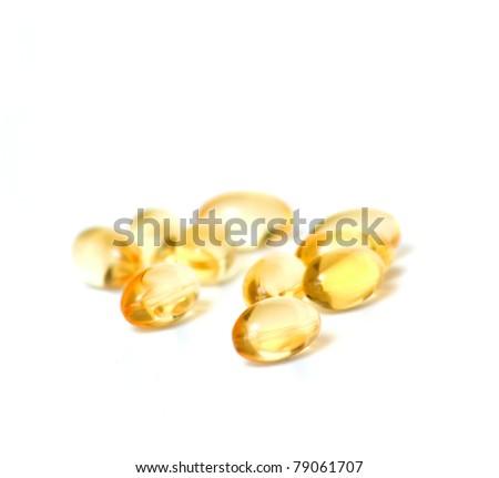 fish oil pills on white background - stock photo