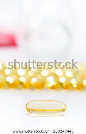 fish oil set in a row on white background - stock photo