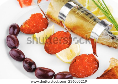 fish olives and red caviar on white plate - stock photo