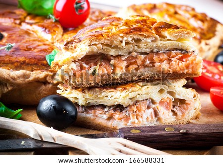 Fish pie with salmon and tomatoes and olives - stock photo