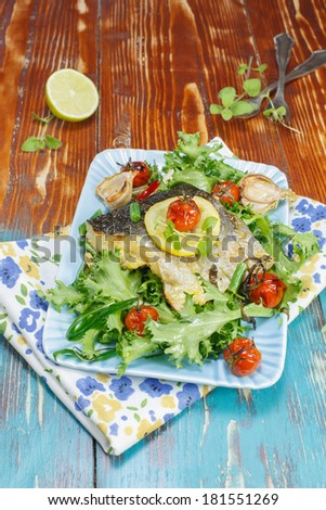 Fish. Plate of cod fish  baked with vegetables - stock photo