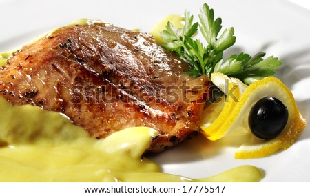 Fish Plate Served with Lemon, Olives and Lemon Sauce. Isolated on White Background - stock photo