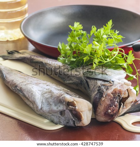 Fish pollock prepared for cooking . Selective focus - stock photo
