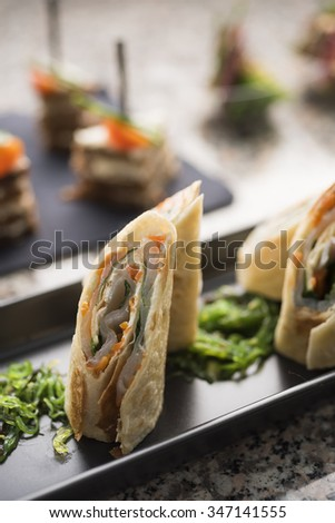 Fish rolls with spicy wakaba - stock photo