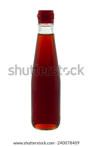 Fish sauce in glass bottle with red lid, isolated on white background