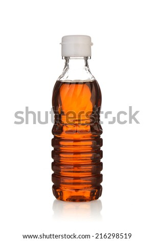 Fish sauce in plastic bottle isolated on white background. - stock photo