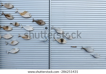 Fish sculpture on the wall - stock photo