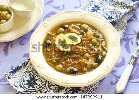 Fish solyanka with capers and olives - stock photo