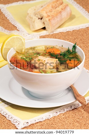 Fish soup served with bread. - stock photo
