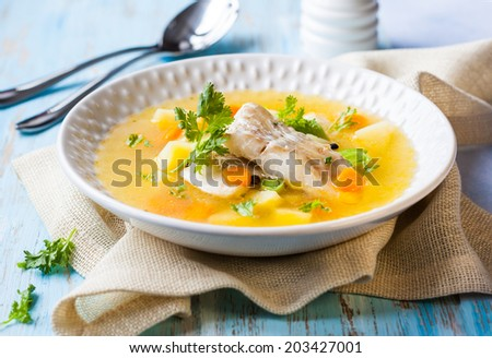 Fish soup with cod and vegetables - stock photo