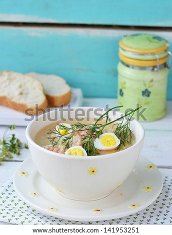fish soup with  quail eggs in to the white bowl - stock photo