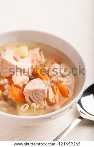 fish soup with salmon and orge perl���© in bowl - stock photo