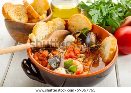 fish soup with toasted bread - stock photo
