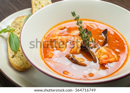 Fish soup with tomatoes and mussels - stock photo
