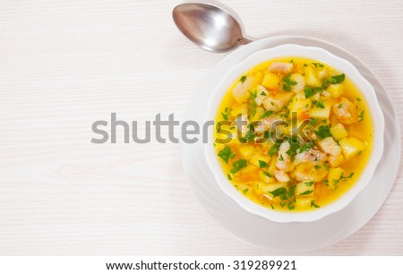Fish soup with vegetables - stock photo