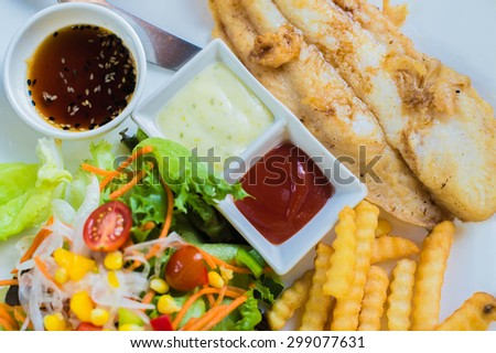 Fish steak with french fries - stock photo