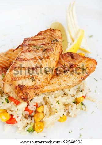 fish steak with rice - stock photo