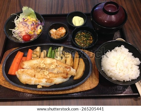 Fish steak with steamed rice, Japanese food bento set - stock photo