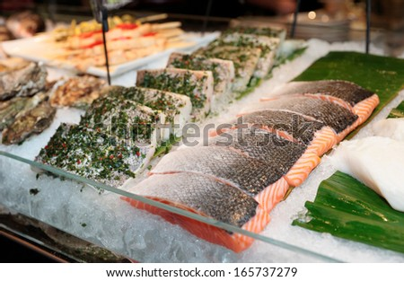 Fish steaks on cooled market display - stock photo