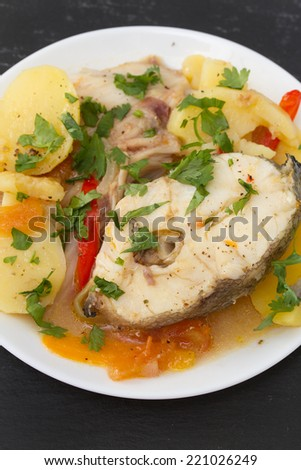 fish stew on white plate - stock photo