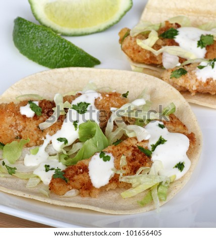 Fish tacos on tortilla shell with lime - stock photo