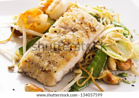 fish with noodles and vegetable - stock photo