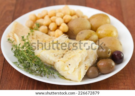 fish with potato and chick-pea - stock photo