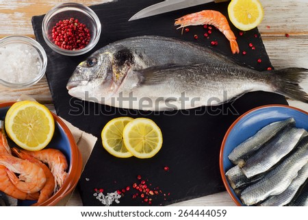Fish  with  spices , salt and shrimps - healthy food. Diet  concept. - stock photo