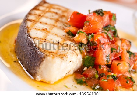 Fish with tomato - stock photo