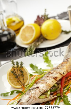 fish with vegetables and lemon - stock photo