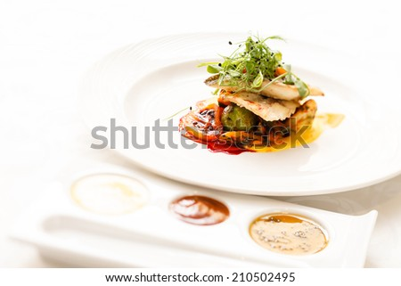 fish with vegetables and sauce