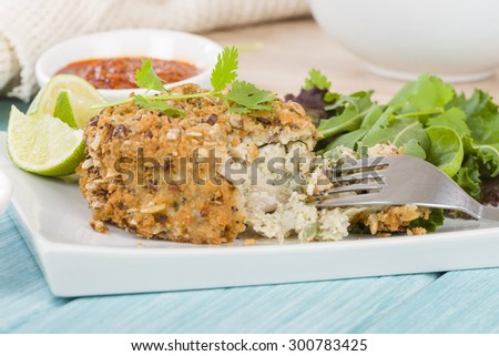 Fishcake - Deep-fried tuna, lime and coriander fishcake served with salad.